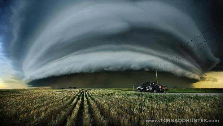 A shelf cloud caught! This is simply an amazing picture taken by storm chasers in Canada of all places!!! Thanks to Beach Harrison for finding this amazing photo! Post your cool pics on our timeline! Make sure you share this if you like it!    Photo Credit: Echo Storm Team