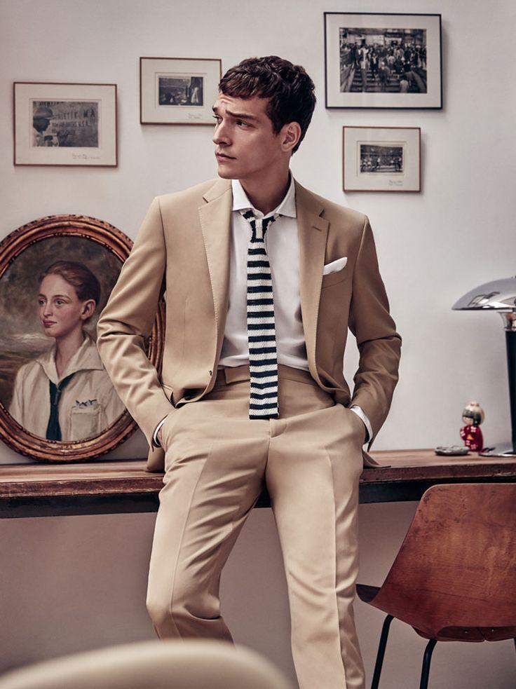 Alexandre Cunha is front and center in a camel Polo Ralph Lauren suit for Codigo Unico.