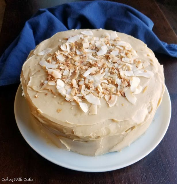 Layer Cake With Sweetened Condensed Milk Frosting Topped With Toasted Coconut Sweetened Condensed Milk Recipes Poke Cake Recipe Condensed Milk Milk Recipes