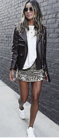 Julie Sarinana + instant glamour + fitted leather jacket + metallic detailing + alternative edge + jacket + statement skirt + white tee   Sneakers: Reebok.