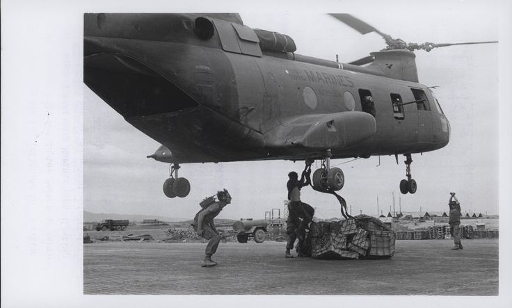 "https://flic.kr/p/xgDrqW | CH-46 Helicopter Delivers Supplies, 1969 | ""Marine Catering Service: A Marine CH-46 helicopter hovers over the Landing Zone at An Hoa Combat Base, south of Da Nang, as Force Logistic Command Leathernecks rig a combat sling filled with supplies for Marines participating in Operation Taylor Common.  This helicopter 'catering service' is the only way that many Marines participating in the operation can be resupplied (official USMC photo by Lance Corporal John Vol..."