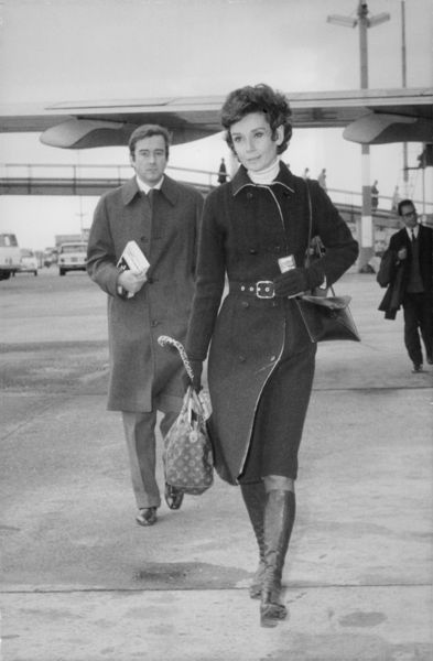 Signora Audrey Hepburn Dotti photographed with her husband Dr. Dotti returning home to Rome after a brief visit to France.