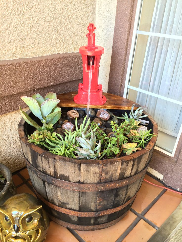Whiskey barrel planter and fountain diy gifts for Diy wine barrel planter