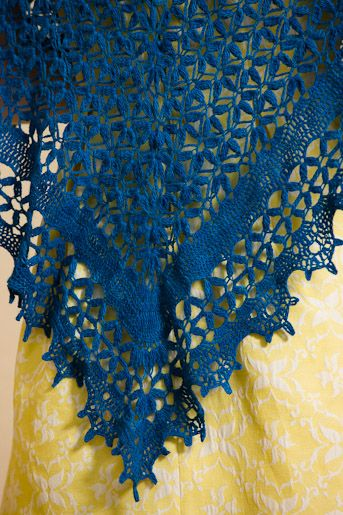 Download Now A diaphanously structured lace shawl, this wrap uses treble clusters to create a striking flower design. A great intermediate level project, this pattern includes stitch diagrams for the visual crocheter. This shawl is a great accessory for any season. Designer Lisa Naskrent Finished Size: About 70″ wide and 35″ tall.Yarn: Malabrigo Lace (100%…