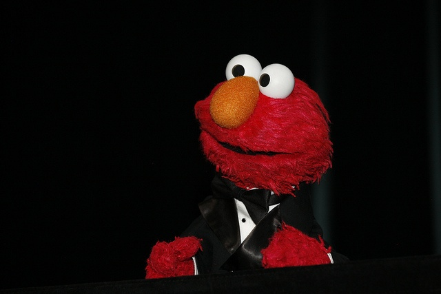 Elmo is dressed to impress.
