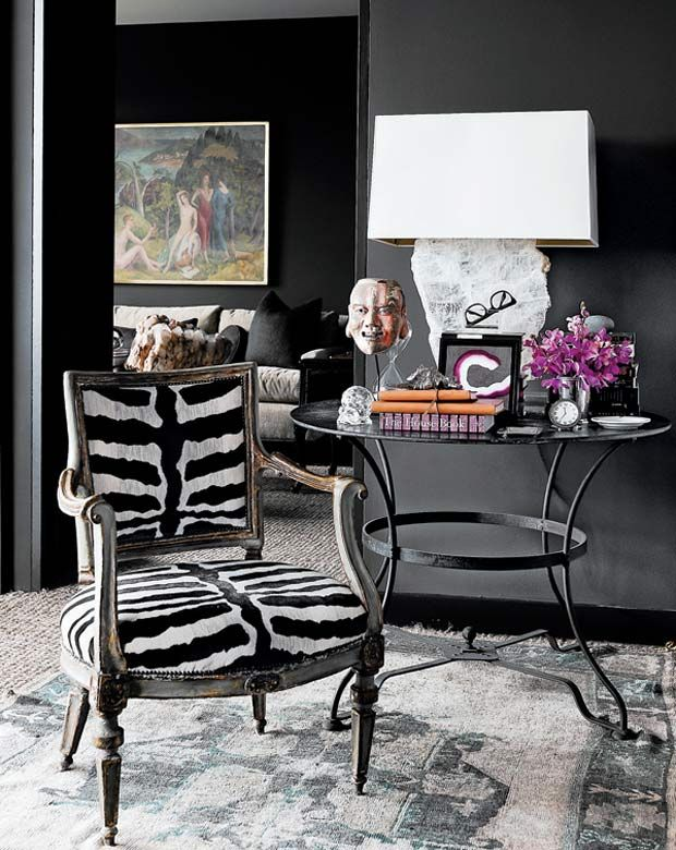 DARINGLY DARK INTERIORS: eclectic #seating area with a #zebra pattern armchair + unique #decor