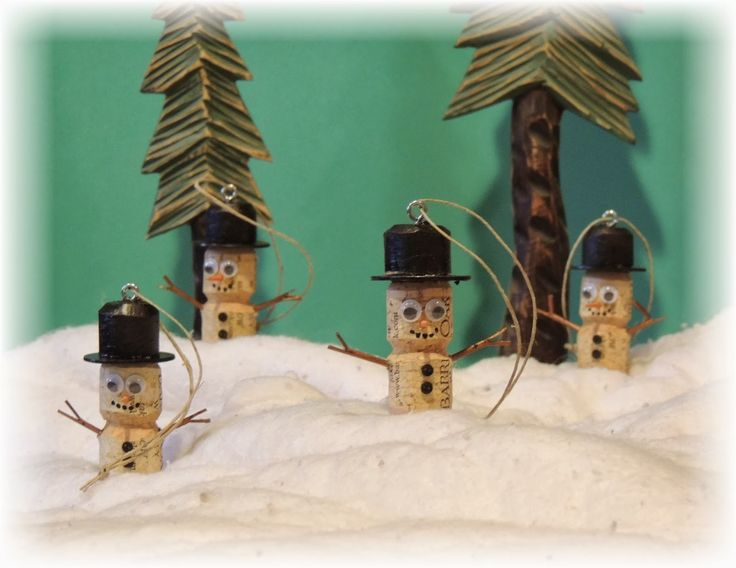 these hand crafted snowman ornaments are made from recycled wine bottle corks