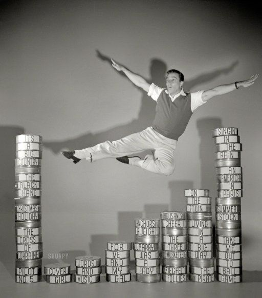 "1952. ""Entertainer Gene Kelly executing leap over film cans labeled with titles of his movies."" From photos by Maurice Terrell for Look magazine."