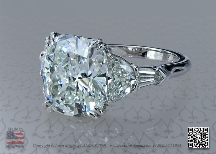Five stone platinum engagement ring with 5 carat cushion and half moon and bullet side diamonds by leon mege