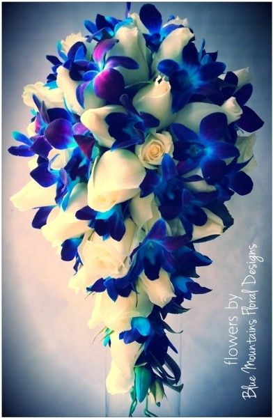 Blue orchid, white rose bouquet- I want this! :)