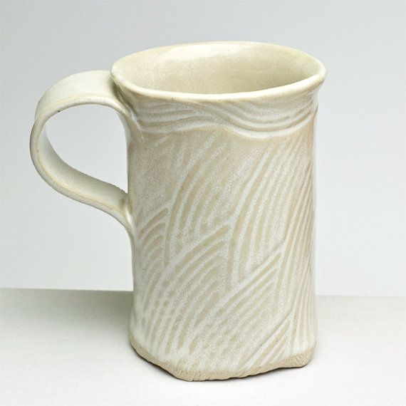This mug is fun to make and its so comfortable to hold. It is made from white stoneware clay that has been rolled out, textured, then cut with a template pattern. The clay is then wrapped around a form, the seam is closed, and the bottom is folded in and over an inserted piece of clay. A great cup! It has been glazed with my favorite Buttermilk glaze and fired to 2380 deg. F. The glaze is food safe and the piece is safe for the microwave, oven and dishwasher. It measures 4-1/4 high, the ...