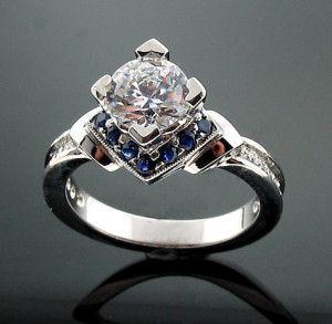 14 K rose gold engagement ring // via Clatter Ring