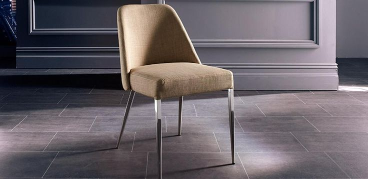 Fabric dining chair with a stainless steel frame