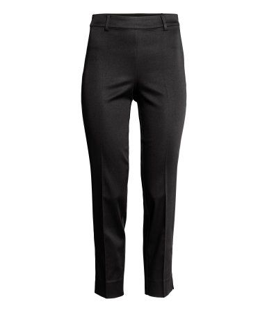 Black. Trousers in woven fabric with one welt back pocket, a concealed zip in the side and slim legs with short slits at the hems.