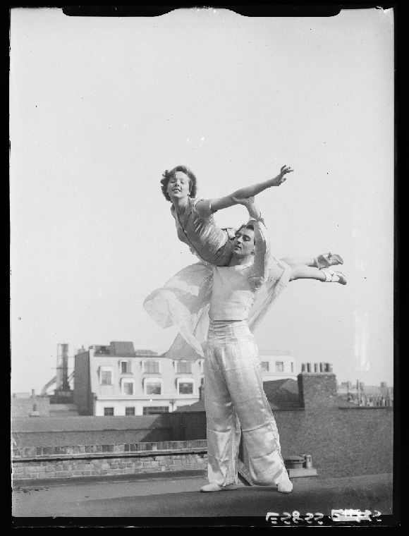 A photograph of Jessie Matthews (1907-1981) dancing with Anton Dolin (1904-1983), taken in October 1935 by Woodbine for the Daily Herald.    The photograph shows the couple rehearsing for the Royal Variety Performance. An actress, singer and dancer, Jessie Matthews was a stage and screen star in the 1920s and 1930s. Anton Dolin was a distinguished English ballet dancer and choreographer. In 1981, he was knighted for his services to dance.