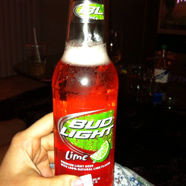 Bud light lime with a shot of grenadine. Yu all must try this!!