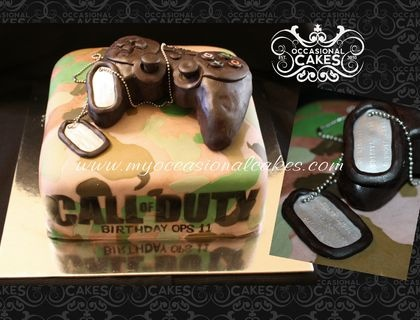 A not so violently bloody version of a Call of Duty cake for my son's 11th  birthday.  The controller is RKT covered in fondant.  The dog tags are fondant as well (chain is non-edible)