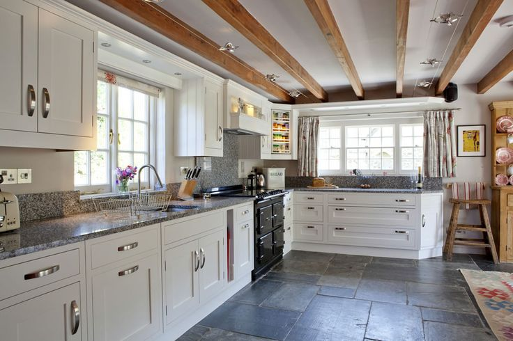 Beautiful farm house kitchen with slate flagstone flooring, Aga conventional cooked and solid pine ceiling beams. Wadebridge, Cornwall