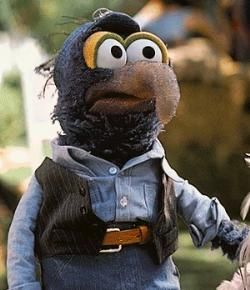 Muppet movie- Gonzo's eyelids are now orange-yellow with dark green rims. Gonzo's nose is now tan with a faint trace of blue. His plumber outfit, consisting of a light blue shirt, a black vest, and a blue visor, is occasionally worn during Season 4 of The Muppet Show, in addition to his tux