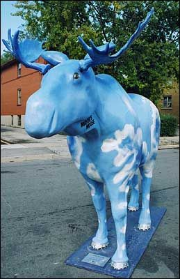 """Toronto Moose in the City # 315: Blue Moose by Jocelyn McTavish. This moose was """"On the Move"""" and could be found at various locations in 2000. Patron:Labatt Breweries Ontario"""