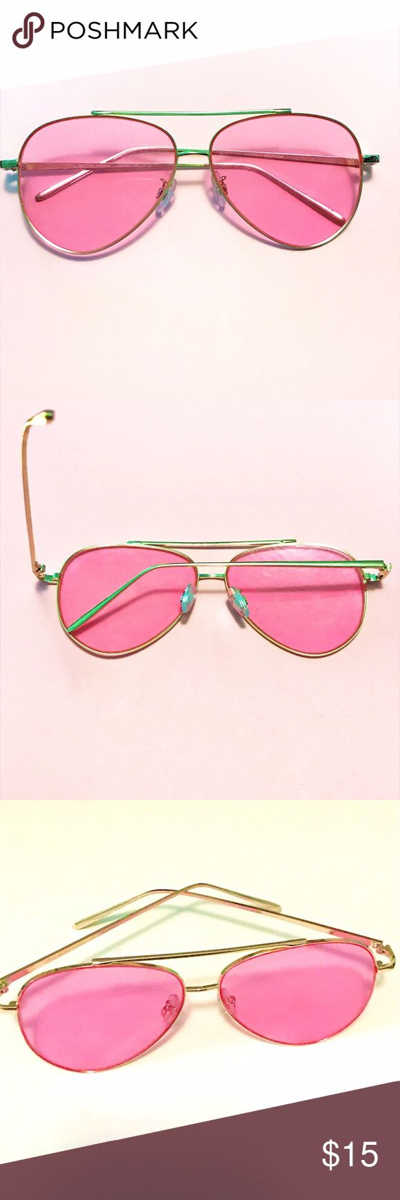 Boho pink lenses with gold rims sunglasses aviator Boho pink lenses with gold rims sunglasses aviators. New without tags. No scratches or defects of any kind these are new never been worn! These are fun and trendy and will add that POP of fun color to make a statement with any summer outfit! ⭐️FAST SHIPPINJ⭐️ Accessories Sunglasses