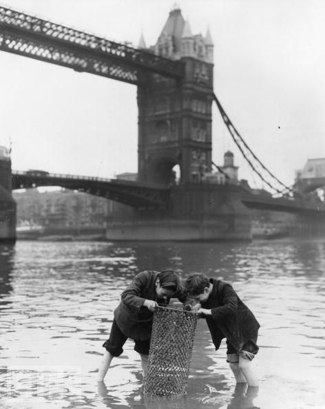 London, 1950s. Don't think I'd stick my feet in the Thames now !!