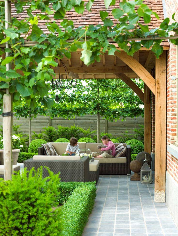 overdekt terras hout lounge groen