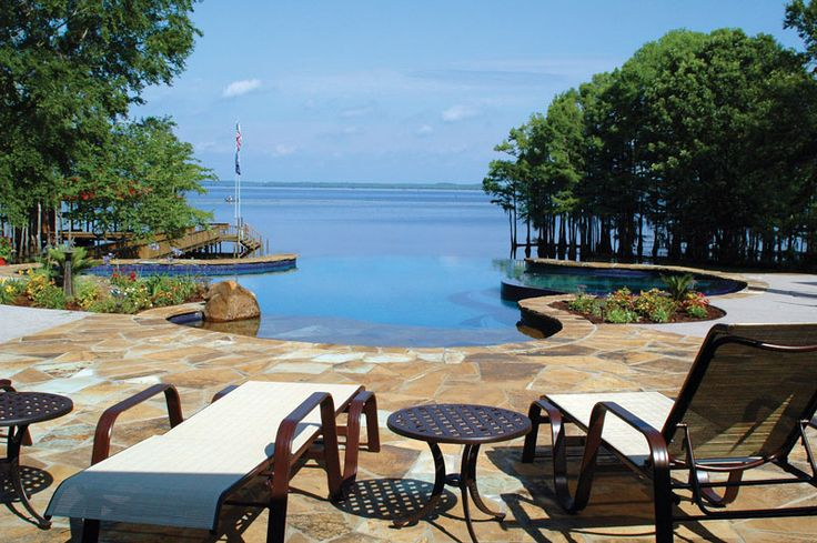 The view of Caddo Lake becomes one with the infinity pool, which features glass tile and varied chopstone. Morehead Pools, Shreveport, Louisiana http://www.luxurypools.com/builders-designers/morehead-pools.aspx