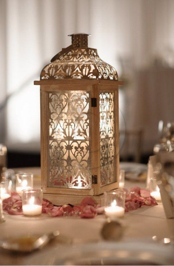 vintage laser cut lanterns wedding centerpiece / http://www.himisspuff.com/100-unique-and-romantic-lantern-wedding-ideas/8/