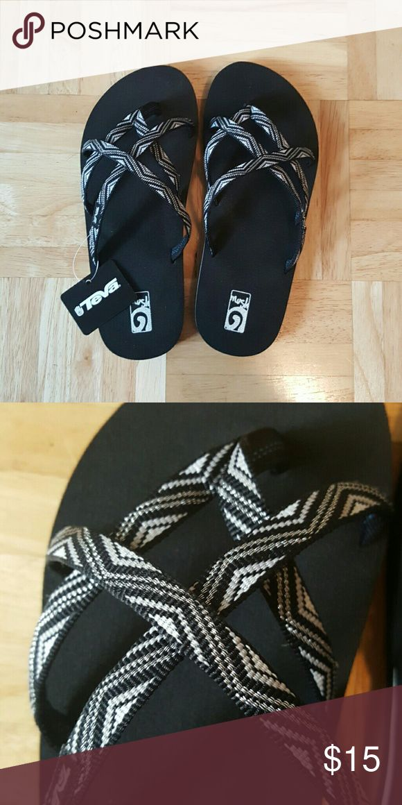 BNWT Black Teva sandals. Kids size 4 BNWT and box black, white, and silver Teva Olowahu sandals. Kids size 4. Super cute. Comes from smoke free home. Teva Shoes Sandals & Flip Flops
