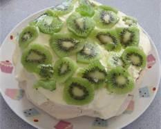 Kiwiana! Pavlova topped with cream and kiwifruit