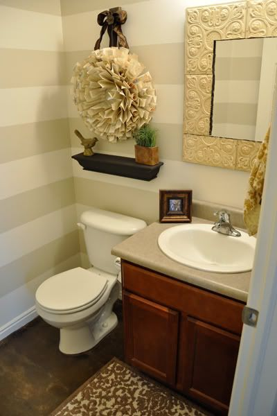 What a pretty look for a half bath! Put those ceiling tiles around the mirror for a cute look