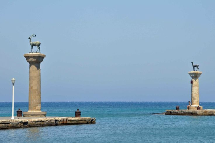 The symbol of Rhodes is the entrance to the ancient port known as Mandraki, Rhodes city, Rhodes, Greece