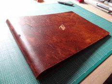 Custom leather A3 photography portfolio for photographer Tom Barnes