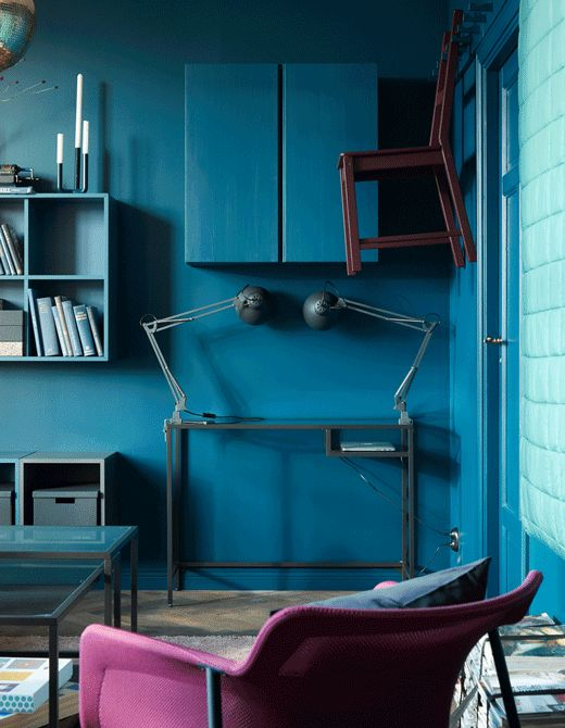 Flexible furniture for small spaces can store your things while blending in like an IVAR cabinet from IKEA. Paint the solid pine cabinet the same color as your walls like this deep blue. Put it with a desk and chair for a hidden home office.