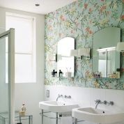A classic floral wallpaper in seafoam, patterned after Chinese porcelain, contrasts with the modernity of the room's clean lines (only try wall covering in a very well-ventilated bathroom).Get more details on this bathroom's stunning wallpaper.