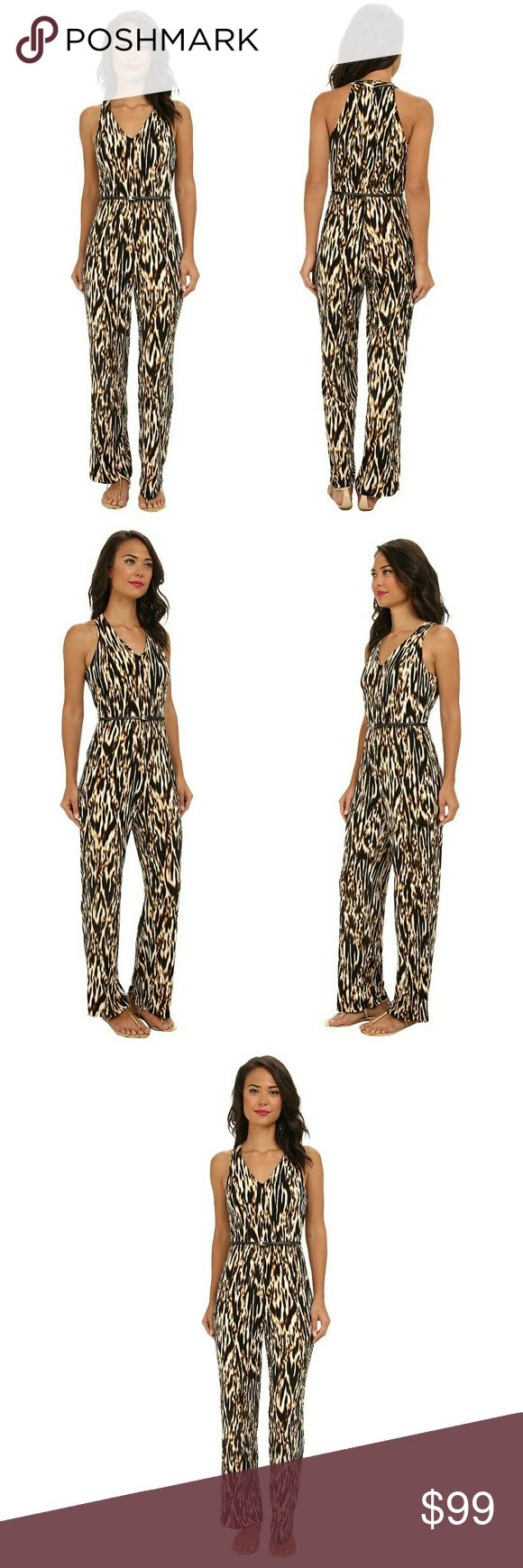 New! Calvin Klein Belted Animal Print Jumpsuit Stand out in Calvin Klein's stunning jumpsuit, complete with a bold animal print and undeniably flattering fit. The skinny belt cinches in your shape.     Removable buckled skinny belt  Allover animal print  V-neckline. Sleeveless with cutaway arm openings  Elasticized waist. Relaxed fit  Back zip with hook-and-eye closure  Inseam, about 32 inches  Polyester/spandex  Dry clean  Retails for $128 Calvin Klein Pants Jumpsuits & Rompers