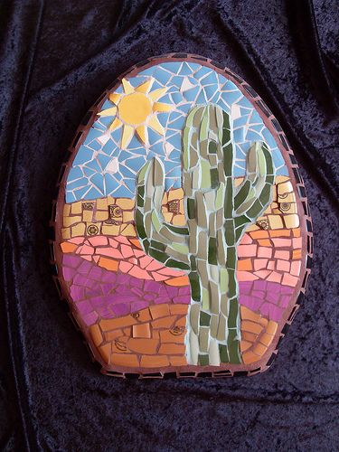 Mosaic cactus art on an old toilet seat.