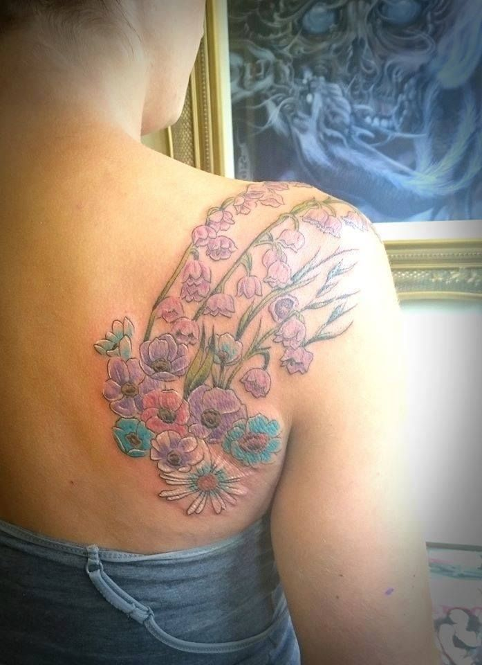 Dainty pastel flowers by Thrax #devilsowntattoos #tattoo #leicester #colour #pastel #flowers