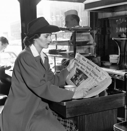 """Reading World War 2 headlines from """"The Detroit News"""" in a downtown Detroit cafe - Photo by Howard McGraw [April 1942]"""