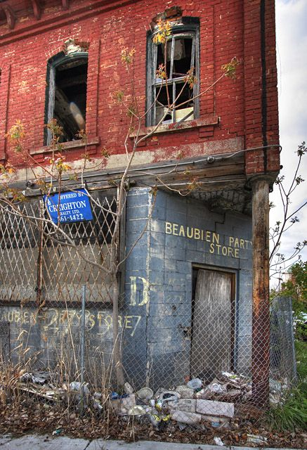 Brush Park, Detroit by Amanda Anger, via Flickr  Ghost/entity in top left window