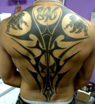 Black Ink Tribal Back Tattoo With Inscription 8% ~ Tribal Tattoo Ideas #56