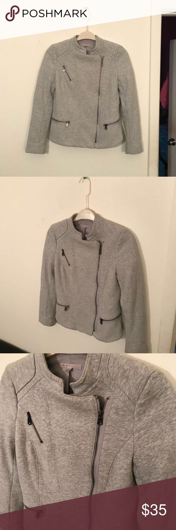 GAP Moto Jacket Heather Gray Zip Up GAP Moto Jacket Heather Gray Zip Up  Perfect for fall and spring  Pewter silver zip up details throughout  Fully lined.  Zipper closures for multiple variations of wear  Shoulder to shoulder: 15'' Length: 20'' Great condition GAP Jackets & Coats