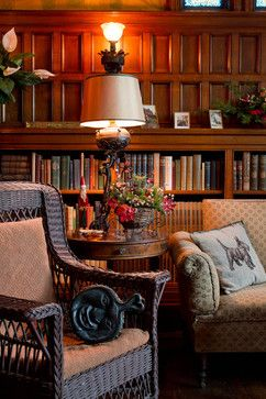 Cozy seating and lovely books make this a perfect cottage room.
