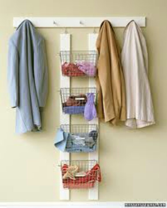 Baskets mounted to wall for things that need to go upstairs or down stairs