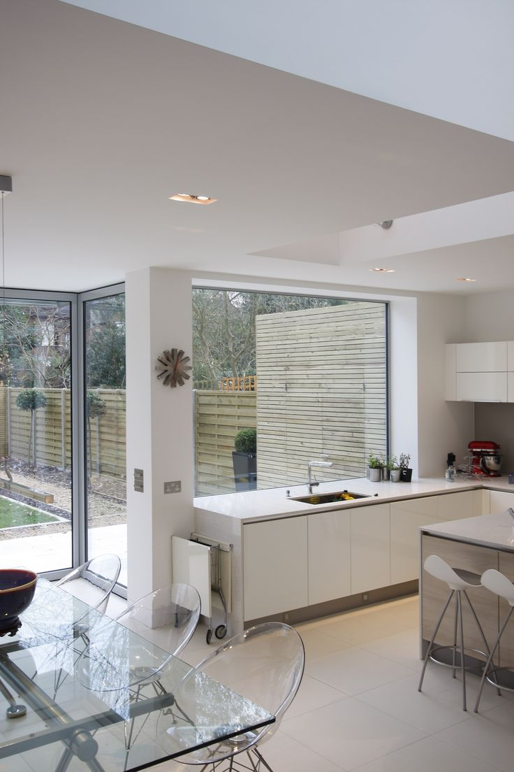 Frameless fixed structural glass window for Kitchen door with window
