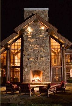 Log Home with a Outdoor Fireplace built into the outer chimney.