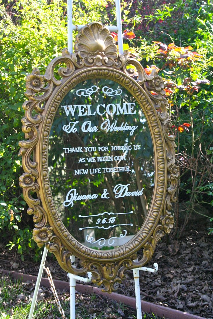 Wedding welcome and thank you sign, painted on an ornate vintage gold mirror.