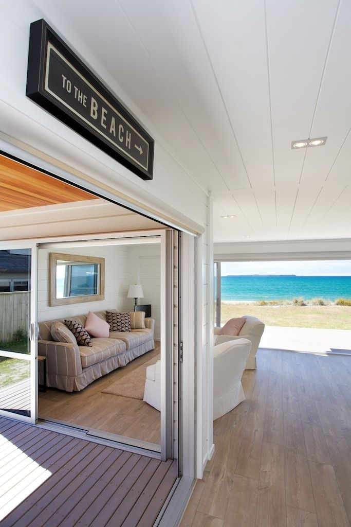 View out to the beach. Stunning all white interior of a Lockwood beach home.
