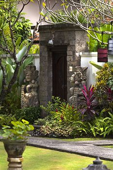 Stone gate - Bali traditional design at White Rose Bali Hotels #Bali